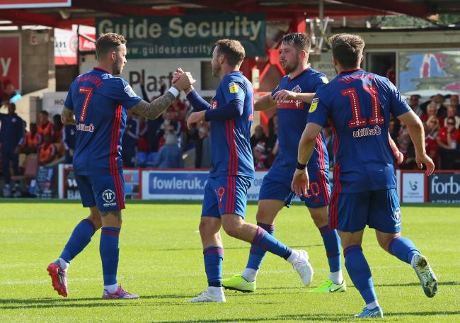 Aiden McGeady is congratulated by his team-mates after scoring Sunderland's second goal in their 3-1 win at Accrington Stanley - the winger is one of nine different players to have scored in the first nine games of the season