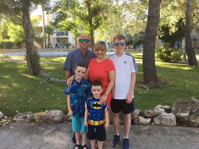 Regan and Jenson Airey with parents Chris and Elizabeth and older brother, Kieran