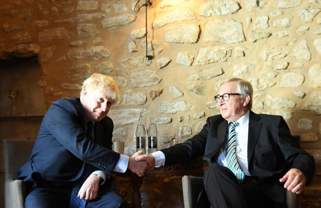 Prime Minister Boris Johnson with European Commission President Jean-Claude Juncker, inside Le Bouquet Garni restaurant in Luxembourg, prior to a working lunch on Brexit. Picture: Stefan Rousseau/PA Wire