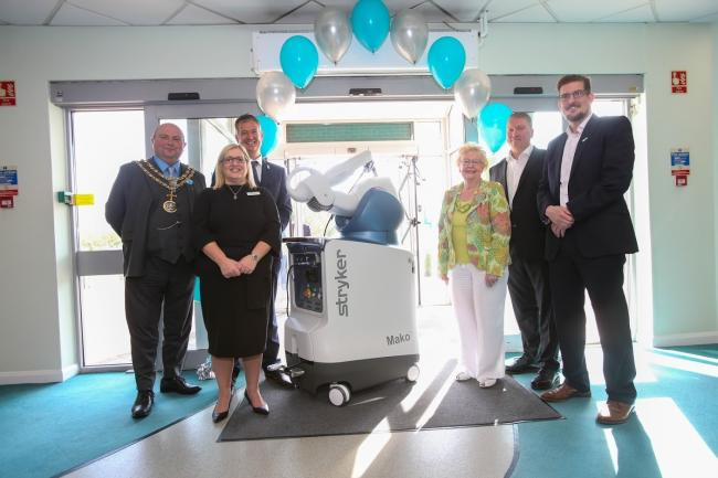 A new Stryker Mako system is welcomed to BMI Woodlands hospital in Darlington. Pictured are Mayor of Darlington Nick Wallis, Hospital Executive Director Debbie Dodds, Consultant Orthopaedic Surgeon Mr James Webb, Darlington Council Leader Heather Scott, C