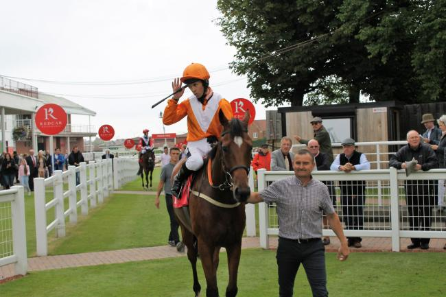 Mr Coco Bean and Graham Lee return to the Redcar winner's enclosure after their recent victory. Picture: Peter Barron