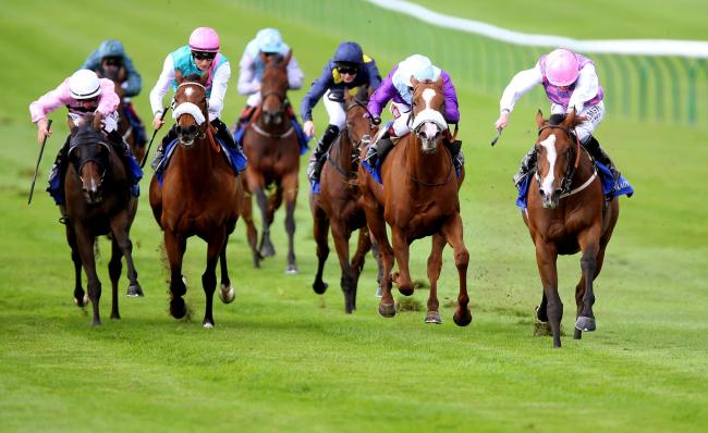 Agincourt (right) ridden by Ryan Moore wins The Tasleet British EBF Rosemary Stakes  at Newmarket Racecourse