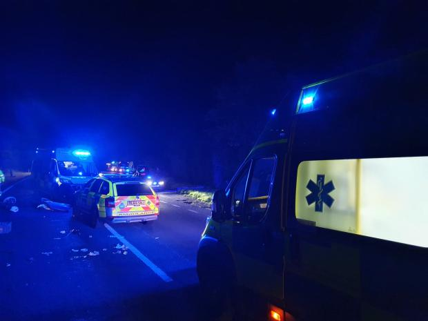 The Northern Echo: Police and ambulance crews at the scene of the crash on the A59. Picture: Andy Creasey / Station Manager with North Yorkshire Fire & Rescue Service