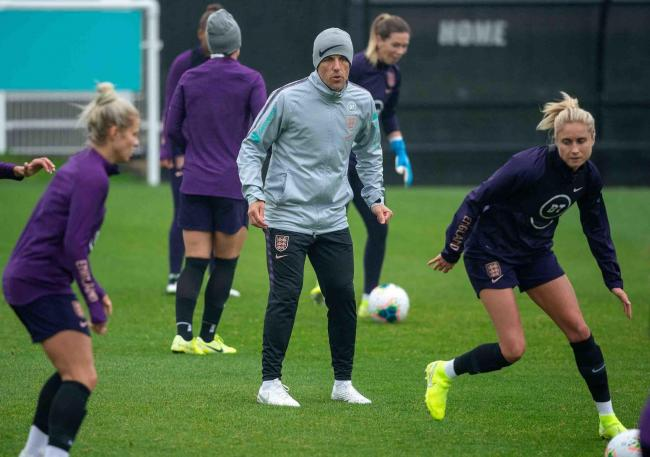 England boss Phil Neville watches his side's skipper, Steph Houghton, during a training session held at Spennymoor Town's Brewery Field ground yesterday