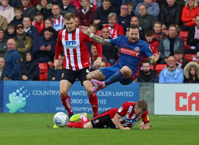 Chris Maguire is fouled at Lincoln City on Saturday.