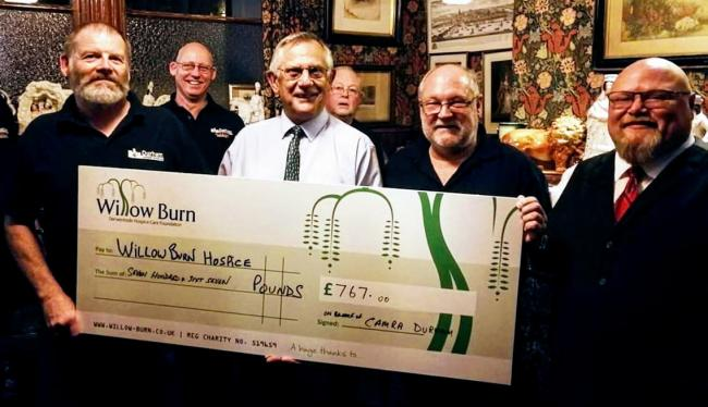 Paul Jackson, white shirt, receives cheque for £767 on behalf of Willow Burn Hospice, from members of the Durham branch of Camra, from left, Paul Dobson, Nick Young and Sean Quilty. The money was raised at the recent Durham Beer Festival
