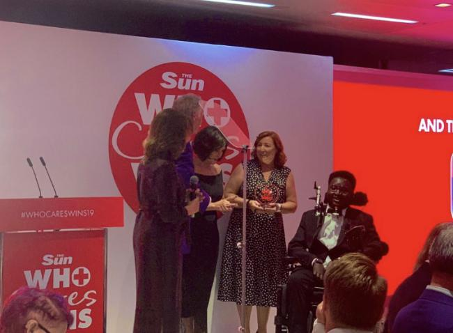 Debi McKeown, lead nurse for therapeutic support and volunteer Ify Nwokoro receive their Unsung Hero Award from medical broadcaster Dr Hilary Jones and Strictly Come Dancing head judge Shirley Ballas