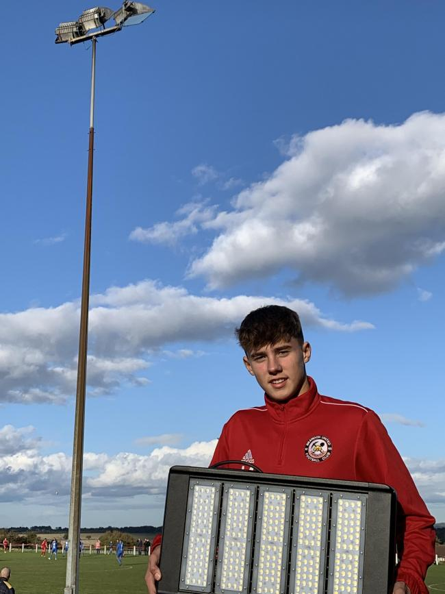 Brandon United's Brad Chisholm with one of the damaged floodlights at the welfare ground in the village