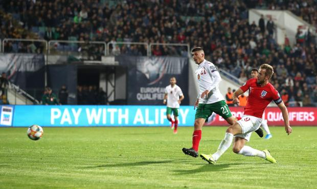 The Northern Echo: England's Harry Kane scores his side's sixth goal of the game during the UEFA Euro 2020 qualifying match at the Vasil Levski National Stadium, Sofia, Bulgaria. Picture: PA