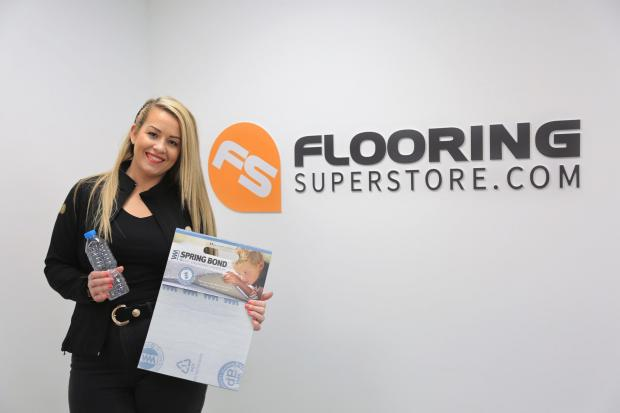 Jessica Fox, Connection Flooring marketing operative, with the recycled underlay and a plastic bottle