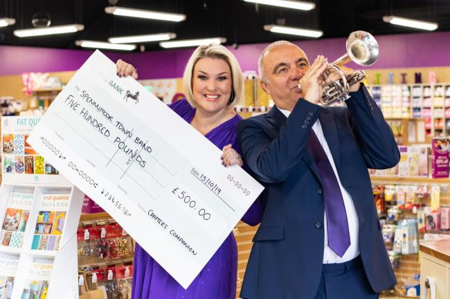 Dragon's Den star Sara Davies and the vice president of the band, Hugh Stephenson celebrating the cash boost