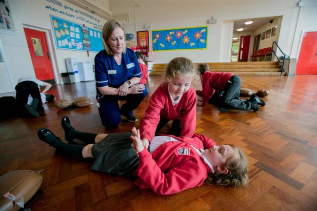Eloise Shearer, a chief clinical cardiology physiologist, showing pupils from Shotley Bridge Primary School how to do CPR during Restart a Heart day Picture: SARAH CALDECOTT