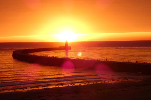 The Northern Echo: The sunrise at Roker Pier. Picture: Pam Alex Ditch / Northern Echo Camera Club