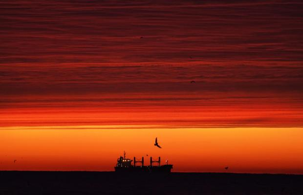 The Northern Echo: A ship sits out at sea before the sun rises off the coast of Whitley Bay, Northumberland. Picture: Owen Humphreys / PA Wire