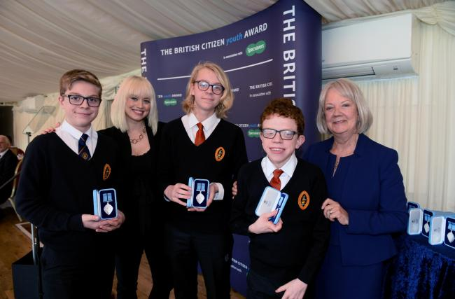 Andrew and James Lunn and Marcus Weston receiving their British Citizen Youth Awards from Kimberley Wyatt and Dame Mary Perkins. British Citizen Youth Awards - Oct 2019