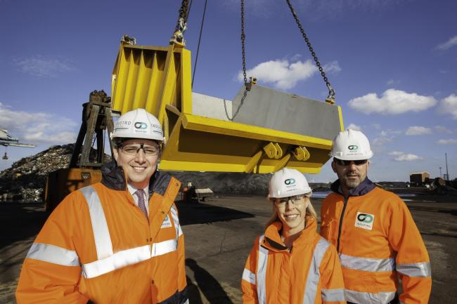 From left, Tees Valley Mayor Ben Houchen and Industro's John Betts and Joanne Bell in front of the new skip built for Redcar Bulk Terminal