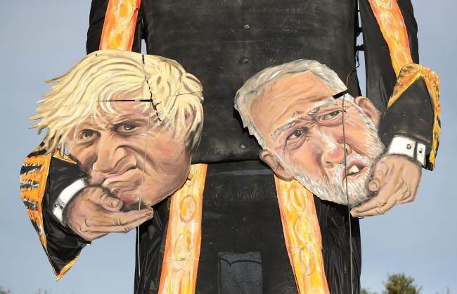 The heads of Prime Minister Boris Johnson and Labour party leader Jeremy Corbyn, made by the Edenbridge Bonfire Society at Breezehurst Farm Industrial Park, which will be burned at an annual bonfire celebration in Edenbridge, Kent. PA Photo. Picture date: