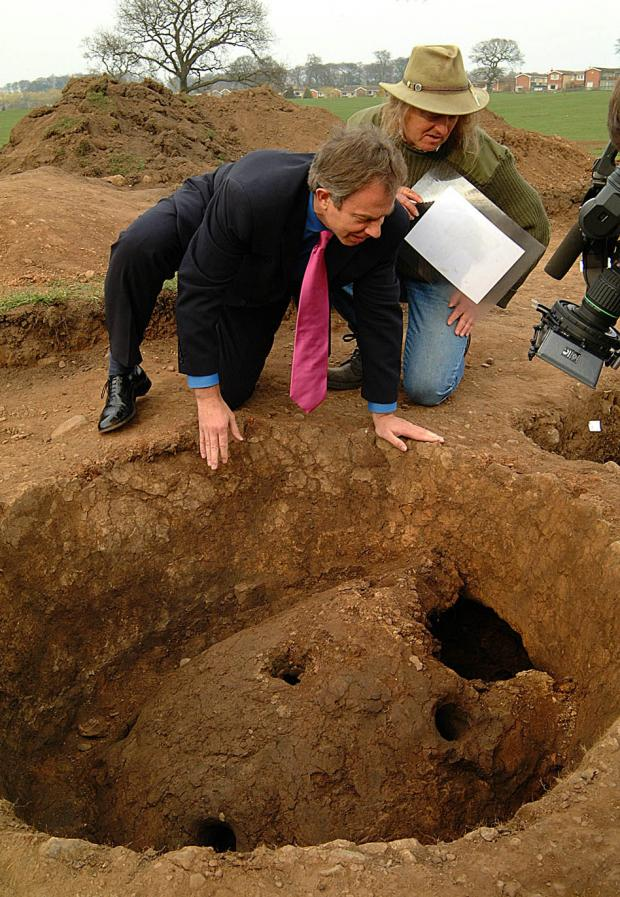 The Northern Echo: Prime Minister Tony Blair visiting the Time Team excavation at East Park, Sedgefield, in 2002. He is looking into a kiln, the most exciting find on the site which showed that there was industrial work going on there in the 2nd Century