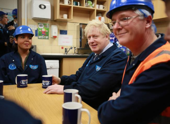 Boris Johnson sits down for a cup of Tetley Tea with staff at the Eaglescliffe factory.