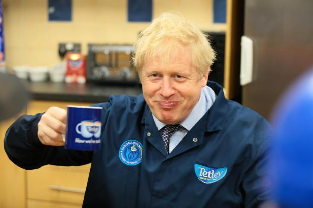 The Northern Echo: Boris Johnson enjoying a cup of Tetley tea during his visit to the Eaglescliffe factory. Picture: Sarah Caldecott