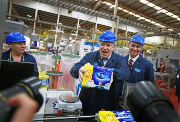 The Northern Echo: Boris Johnson poses for the cameras during his tour of the Tetley tea factory in Eaglescliffe. Picture: Sarah Caldecott