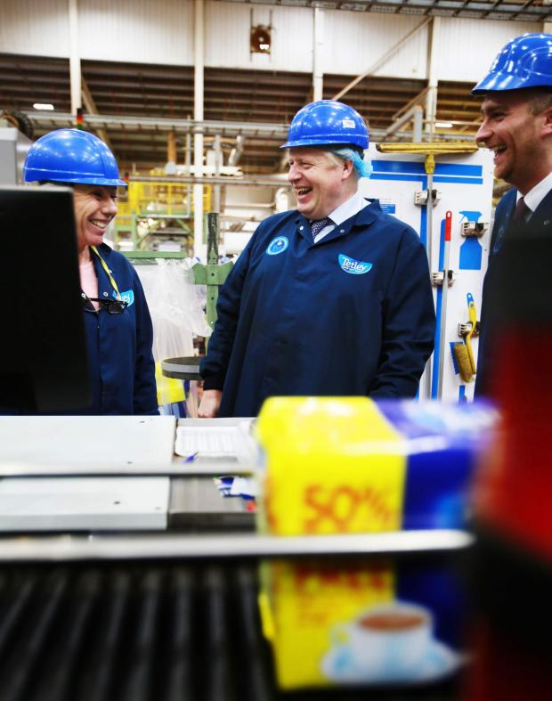 The Northern Echo: Boris Johnson shares a joke with staff during his tour of the Tetley tea factory at Eaglescliffe. Picture: Sarah Caldecott