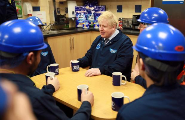 The Northern Echo: Boris Johnson enjoys a cup of Tetley tea as he chats with staff at the Eaglescliffe factory. Picture: Sarah Caldecott