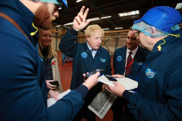 The Northern Echo: Boris Johnson speaking to reporters during his tour of the Tetley tea factory in Eaglescliffe. Picture: Sarah Caldecott