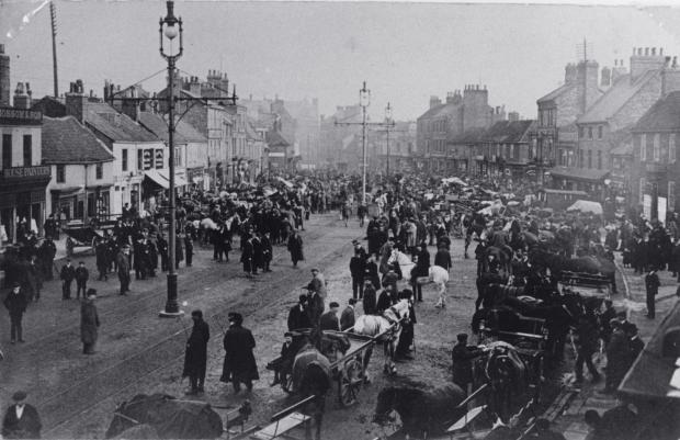 The Northern Echo: Looking down Bondgate towards High Row in Darlington, with a horse market in full swing