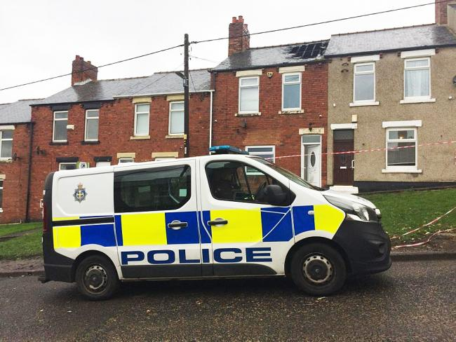 Police at the fire-damaged house in Argent Street, Easington Colliery