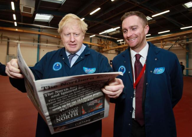 Boris Johnson visits Tetley in Eaglescliffe, he is pictured with Thursday's Northern Echo with Matthew Vickers of Stockton South Picture: SARAH CALDECOTT