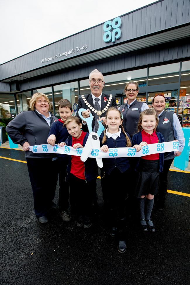 Romanby Primary school pupils help the Mayor of Northallerton Cllr John Forrest, store manager Kirsten Darbyson and staff members Bev Anders and Michaela Bell cut the ribbon to open the Co op petrol station Picture: JOHN MILLARD/UNP