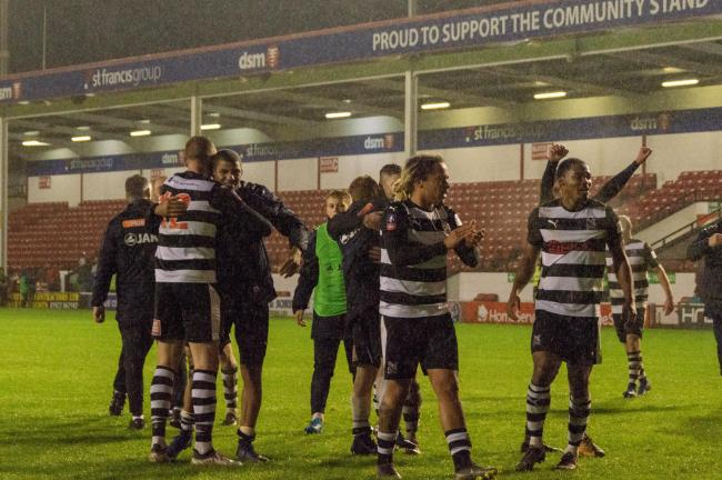 Darlington's players celebrate after their weekend draw at Walsall