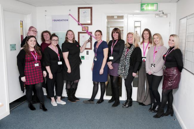 Anna Turley cuts a ribbon to mark the SafeLives Leading Light accreditation at Foundation in Redcar together with manager Kira Lumb and members of staff. Picture: STUART BOULTON