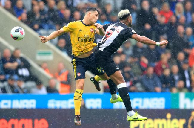 Granit Xhaka, pictured challenging Joelinton, is a January transfer target for Newcastle United