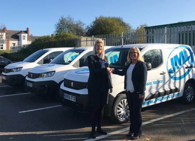 Tricia Stones, left, key account manager at Simon Bailes Peugeot, hands over the keys to Judith Fahey, JML's fleet manager