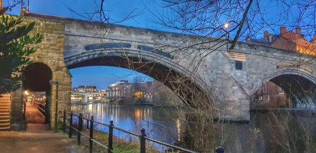 The Northern Echo: Shaun Howey On Durham riverbank looking up at framwellgate bridge.