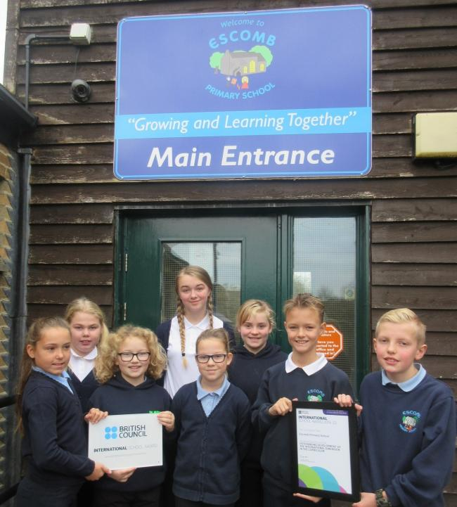 A group of Escomb Primary School pupils hold the award