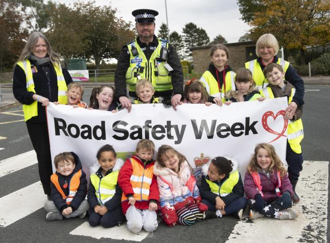 Children from Little Learners Nursery in Scorton are pictured with PCSO Vincent Long, Janice Randles and Sarah Ditchburn from the nursery