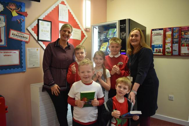 Brandon Primary School has just installed a book vending machine to get pupils to be enthusiastic about reading and encourage them to try new titles. The first recipients of tokens to get books out are pictured here with Sarah Forster, director of North E