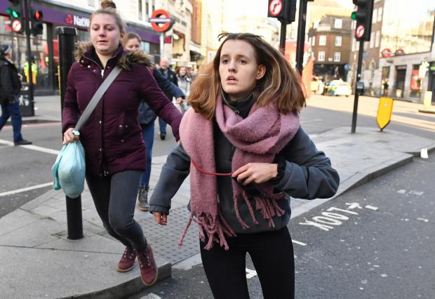 The Northern Echo: People heading away from the vicinity of Borough Market in London after police told them to leave the area following an incident on London Bridge. Picture: PA