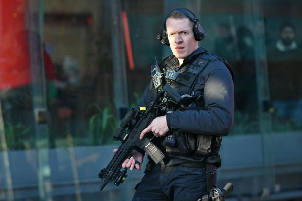 The Northern Echo: An armed officer in the area of London Bridge and Borough Market, London. Picture: PA