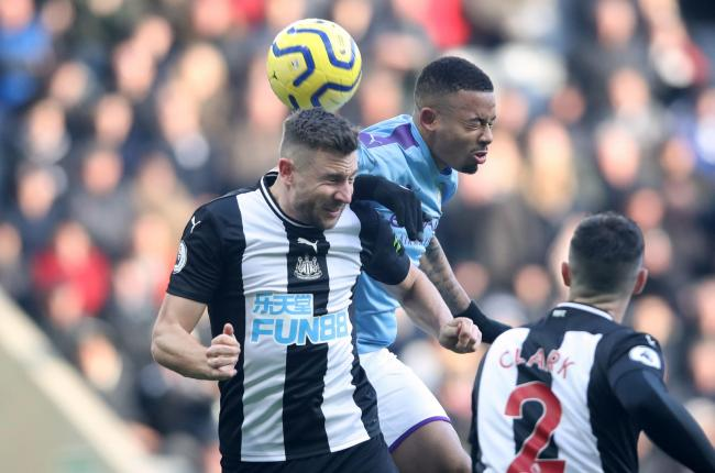 Paul Dummett challenges for a header with Gabriel Jesus (Picture: Owen Humphreys/PA Wire)