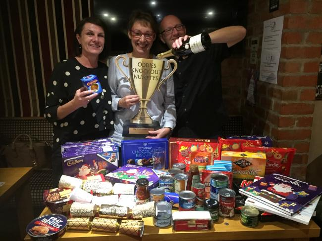 Lynne Richardson (centre) is pictured with overall winners, Angela Nicholson (ex-employee) and Paul Nicholson with the donated food.