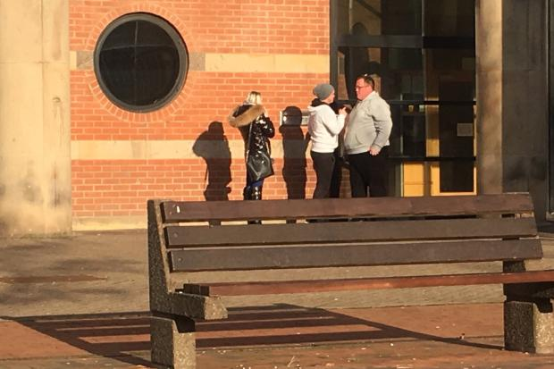Steve Iverson, far right in the grey top, was greeted outside of Teesside Crown Court