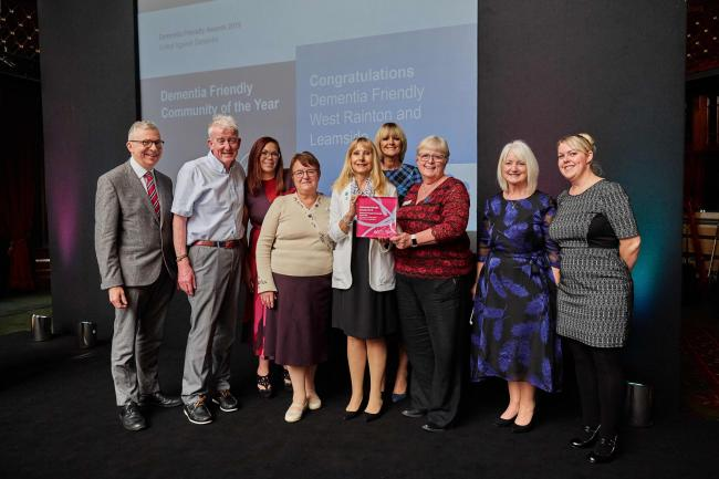 Volunteers from West Rainton and Leamside, who got the initiative off the ground, have been named Dementia Friendly Community of the Year at the National Dementia Friendly Awards in London. members of the groups are pictured here with Jeremy Hughes, Alzhe