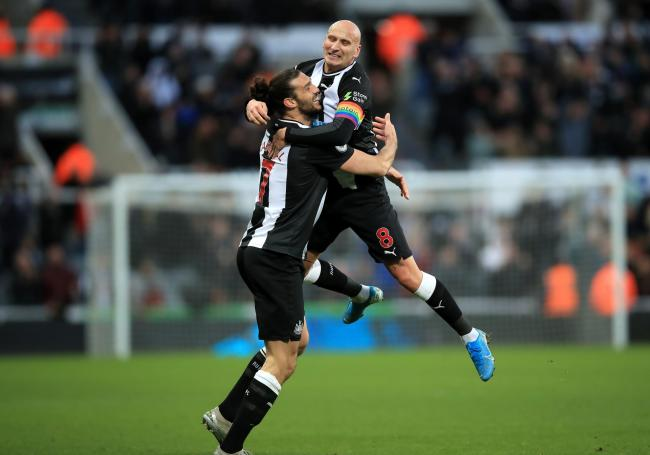 Andy Carroll celebrates with Jonjo Shelvey after the pair combined for Newcastle United's first goal in their 2-1 victory over Southampton on Sunday - the striker is thoroughly enjoying his second spell at St James' Park