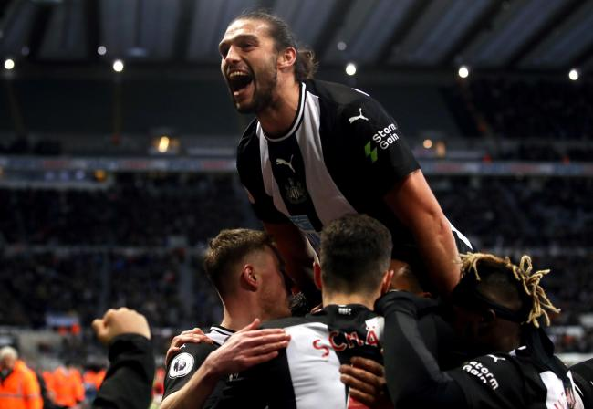 Andy Carroll leads the celebrations in the wake of Federico Fernandez's winner in Newcastle's 2-1 victory over Southampton (Picture: Owen Humphreys/PA Wire)