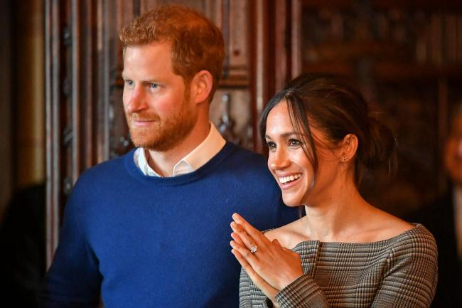 Prince Harry and Meghan Markle watch a performance by a Welsh choir in the banqueting hall during a visit to Cardiff Castle. Picture: Ben Birchall/PA Wire