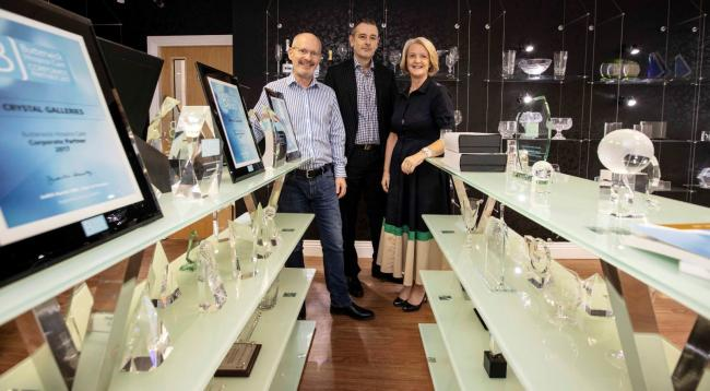 Peter Taylor (centre) of investor UKSE with Jeremy and Joanne Lowes at Crystal Galleries